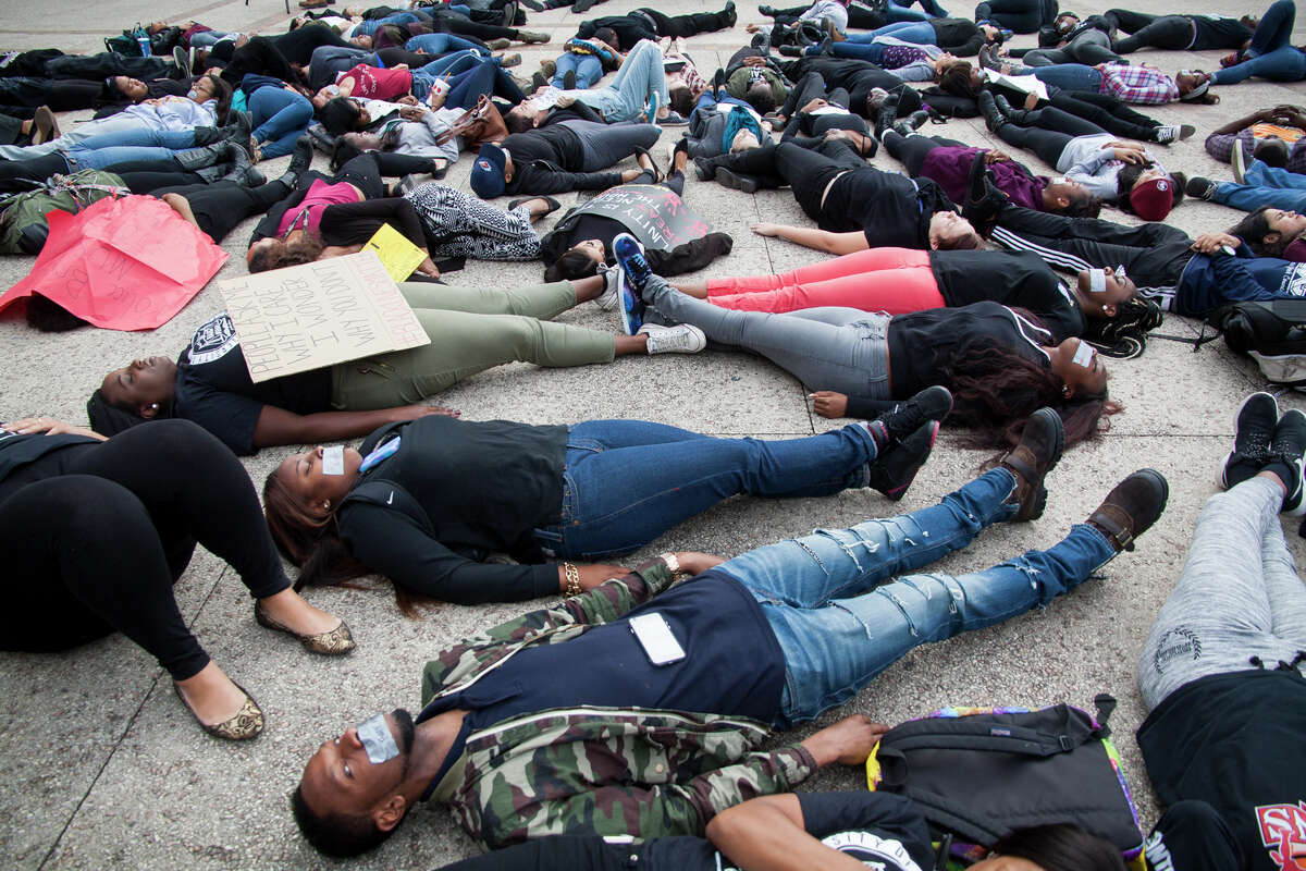 """About eighty UTSA students gathered at Sombrilla Plaza Wednesday Dec. 10, 2014 for a """"Die-in"""" in honor of Michael Brown and Eric Garner, where they laid for 15 and half minutes. The event was sponsored by the UTSA NAACP chapter in an effort to shed light on police brutality and injustice."""