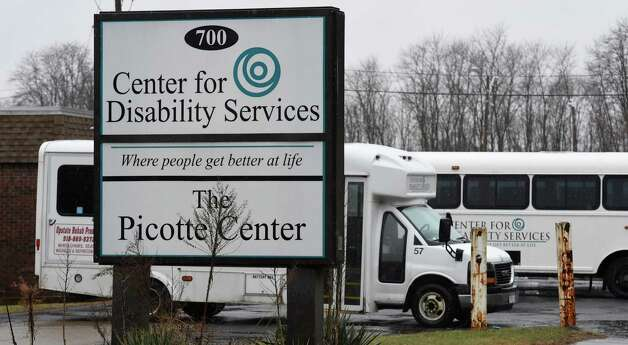 Vans sit outside of the Center for Disability Services at 700 S. Pearl Street Tuesday morning Dec. 9, 2014 in Albany, N.Y.  (Skip Dickstein/Times Union) Photo: SKIP DICKSTEIN