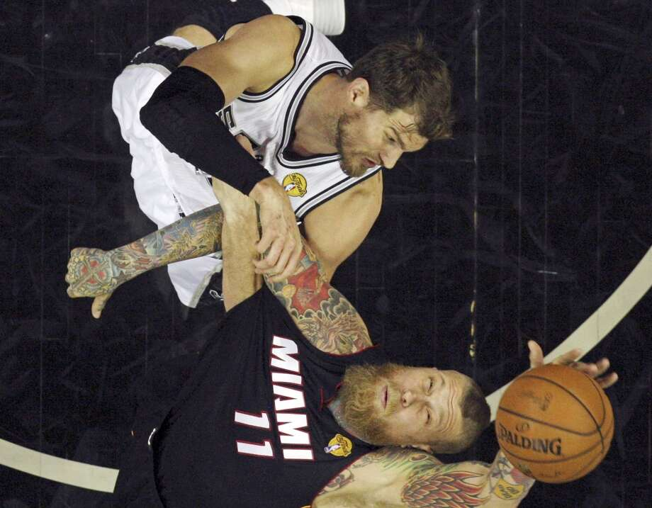 San Antonio Spurs' Tiago Splitter and Miami Heat's Chris Andersen grab for a rebound in Game 5 of the 2014 NBA Finals Sunday June 15, 2014 at the AT&T Center. The Spurs won 104-87. Photo: Edward A. Ornelas, San Antonio Express-News