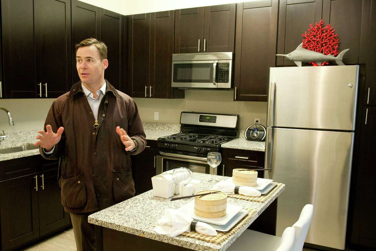 BLT Chief Operating Officer Ted Ferrarone shows off a unit at The Vault Apartments in Stamford, Conn., on Wednesday, December 10, 2014.