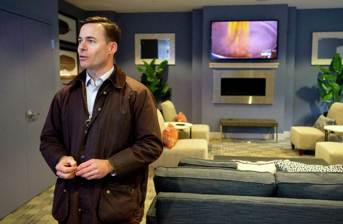 BLT Chief Operating Officer Ted Ferrarone shows off a common area in The Vault Apartments in Stamford, Conn., on Wednesday, December 10, 2014.