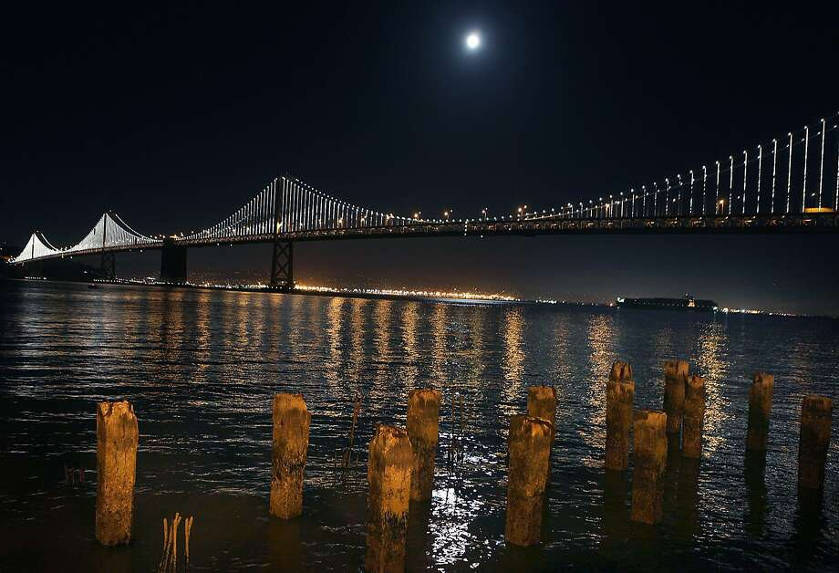 The Bay Lights seen on the Embarcadero at Howard St. in San Francisco, California, on Friday, November 15, 2013.  The Bay Bridge will host the light sculpture, designed by artist Leo Villareal until March of 2015. Photo: Liz Hafalia, The Chronicle