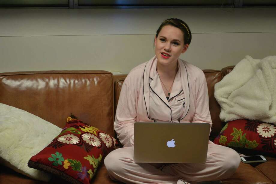 """Houston Chronicle intern Amber Hewitt doesn't need Santa Claus, thankyouverymuch. She has her new bestie, country-turned-pop star Taylor Swift, delivering the sweetest gifts of the year to her. Here she is, pictured above, in her """"natural habitat blogging about Taylor Swift in my pajamas,"""" Hewitt said. """"Taylor bought me these and said, '€œPrepare your€™self for the softest  jammies EVER.'€ They'€™re so comfortable I think I want to live in  them.""""What started off innocently enough as a fan blog on Tumblr years ago took a unique turn. Hewitt received the ultimate goodie bag (seriously, these gifts are amazing) from her favorite singer, complete with personalized notes. Read all about Hewitt says she became best friends with Taylor on HoustonChronicle.com. Keep clicking to see all the cool gifts Hewitt received from Taylor Swift. Photo: Melissa Ward Aguilar / ONLINE_YES"""