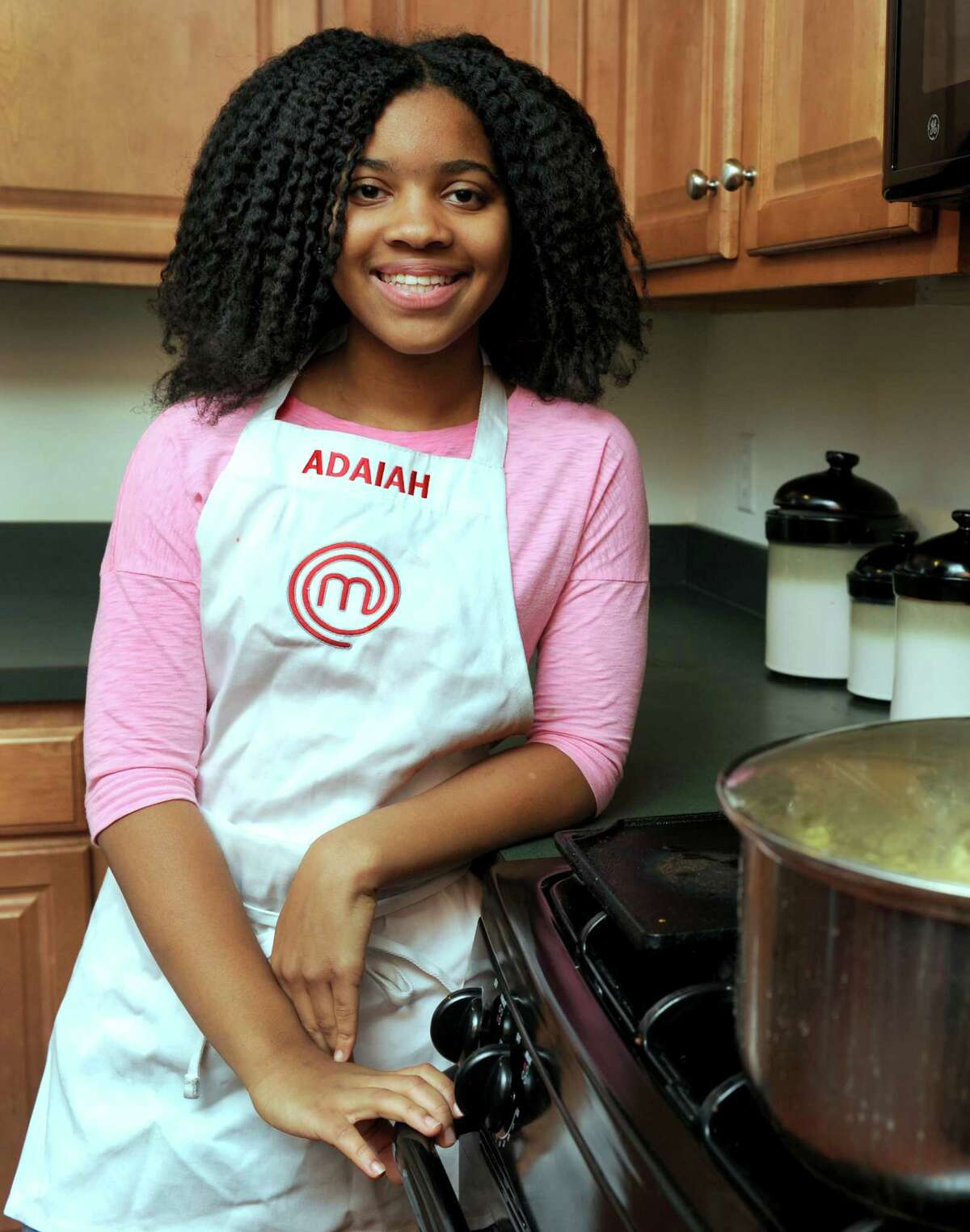 Adaiah Stevens, 12, of Danbury, Conn. is a contestant on the Fox TV show, Master Chef Junior. She is photographed in her home Wednesday, Nov. 12, 2014.