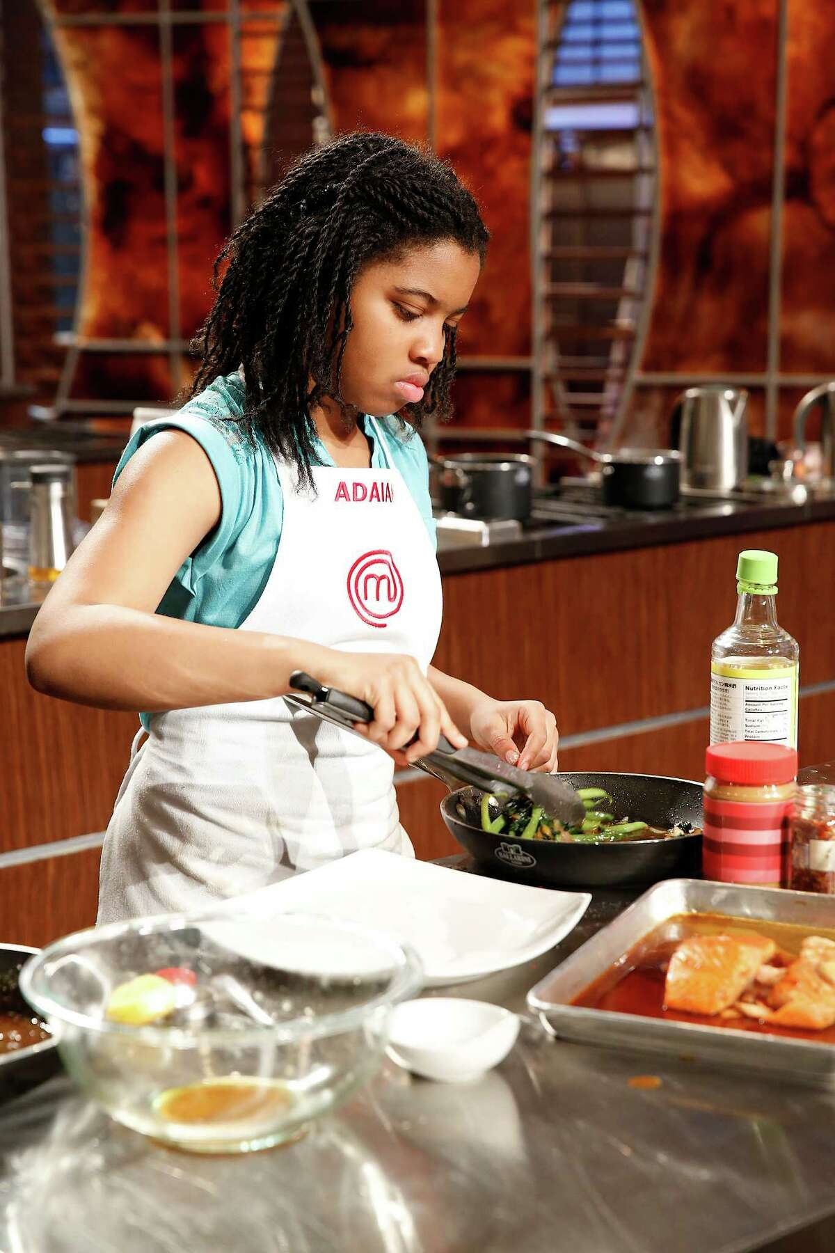 """Adaiah Stevens of Danbury cooks a salmon dish for this week's episode of """"MasterChef, Junior."""" Stevens, 12, made it to the final four of the Fox reality competition before getting sent home this week."""