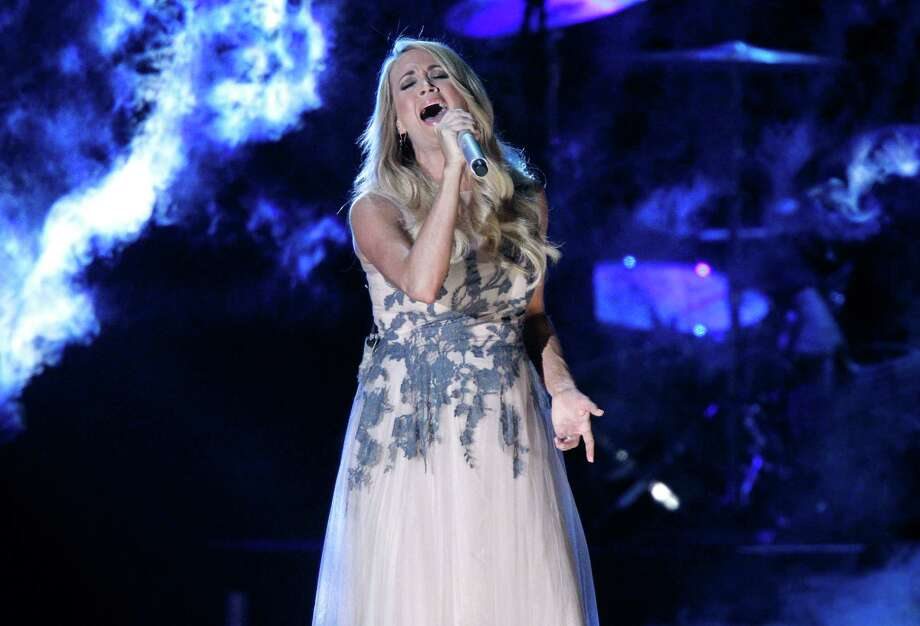 Carrie Underwood performs onstage at the 48th annual CMA Awards at the Bridgestone Arena on Wednesday, Nov. 5, 2014, in Nashville, Tenn. (Photo by Wade Payne/Invision/AP) Photo: Wade Payne,  INVL / Associated Press / Invision