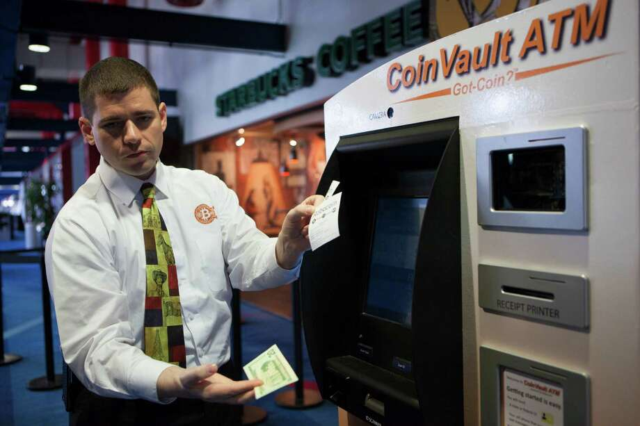 Nick Morphis of CoinVault ATM demonstrates the new bitcoin ATM at the convention center downtown. Photo: Marie D. De Jesus, Staff / © 2000 Houston Chronicle