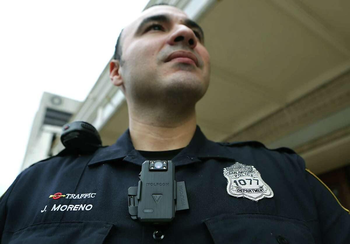 San Antonio Police Officer Johnny Moreno wears a body cam that Chief William McManus spoke to members of city counsel about to be used by certain police officers, if the cameras are approved. Wednesday, Dec. 10, 2014.