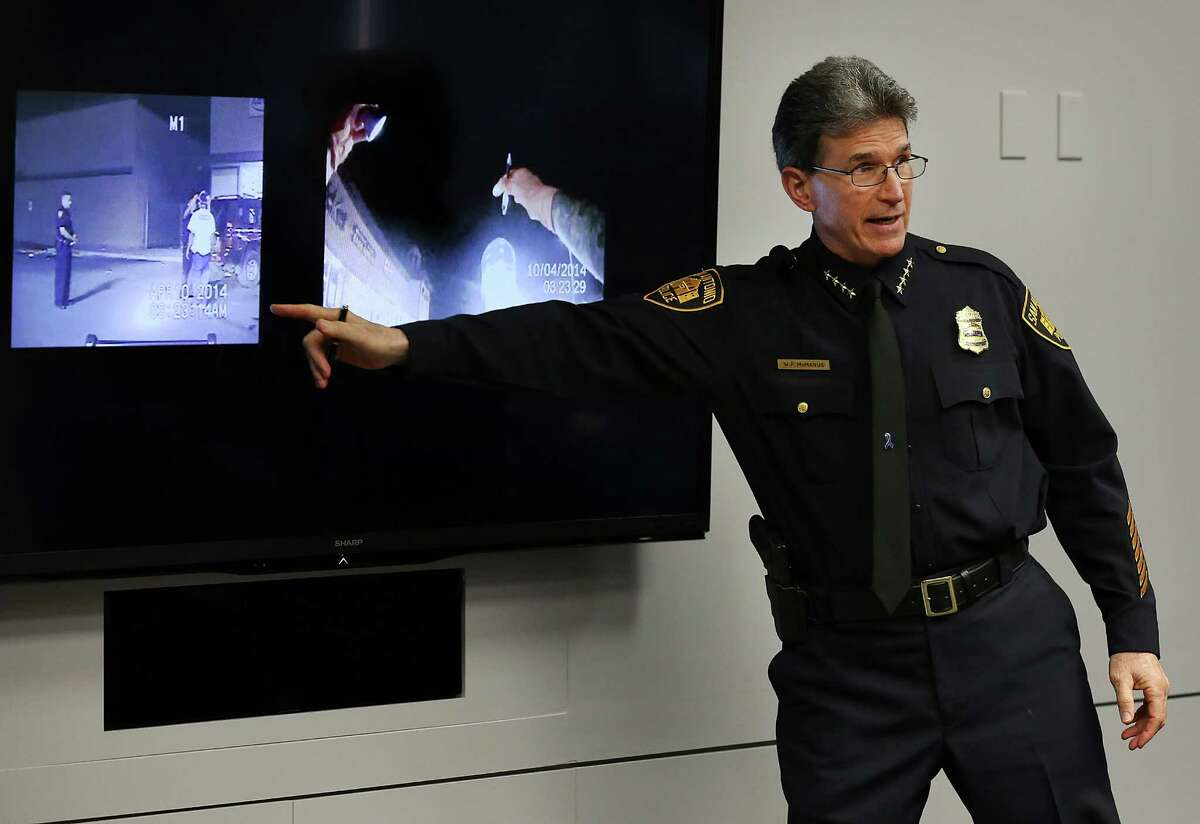 San Antonio Police Chief William McManus shows the different perspective from a car camera and a body camera as he presents his pitch to members of city counsel for purchasing body cams to be used by certain police officers. Wednesday, Dec. 10, 2014.