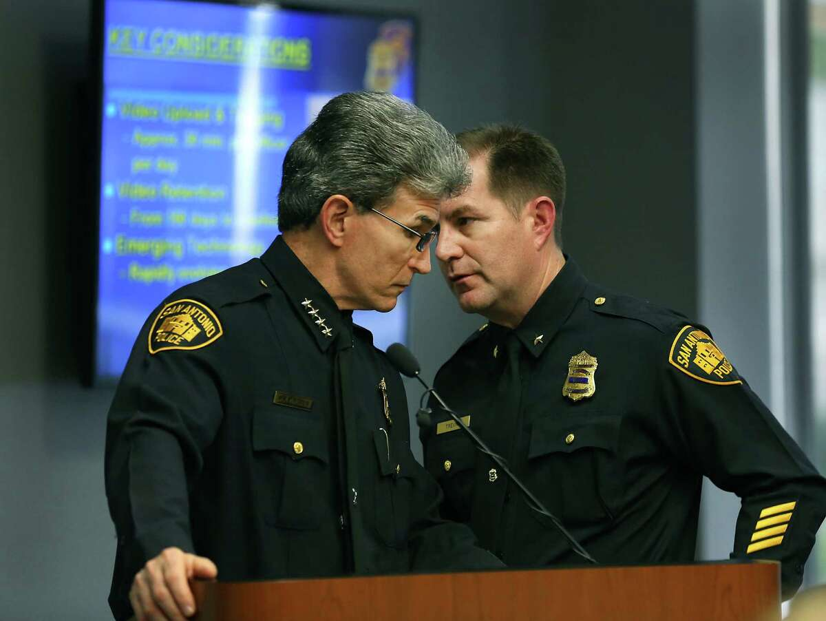 San Antonio Police Chief William McManus, left, confers with Interim Police Chief Anthony Trevino as he presents his pitch to members of city counsel for purchasing body cams to be used by certain police officers. Wednesday, Dec. 10, 2014.