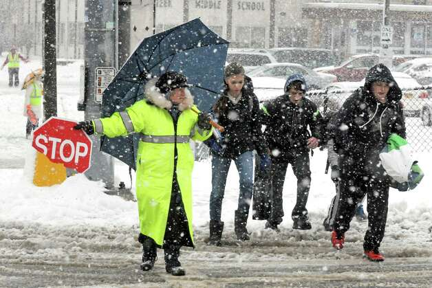 Crossing guard Lil Connor gets children safely accross Sand Creek Road as Sand Creek Middle School lets out for the day on Wednesday Dec. 10, 2014 in Colonie, N.Y.  (Michael P. Farrell/Times Union) Photo: Michael P. Farrell, Albany Times Union / 00029805A