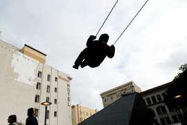 San Francisco City Academy student Adair Perez, 5, swings during the Boeddeker Park grand opening Wedneday.