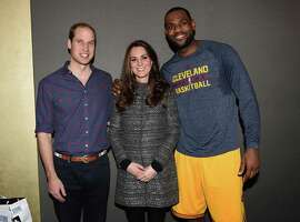 NEW YORK, NY - DECEMBER 08:  Prince William, Duke of Cambridge and Catherine, Duchess of Cambridge pose with basketball player LeBron James (R) backstage as they attend the Cleveland Cavaliers vs. Brooklyn Nets game at Barclays Center on December 8, 2014 in the Brooklyn borough of New York City. (Photo by Tim Rooke - Pool/Getty Images)