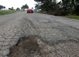 Deep potholes leading to the on-ramp of eastbound I-80 on the south end of Aquatic Park in Berkeley are symptomatic of roads that need replacement, not repair.