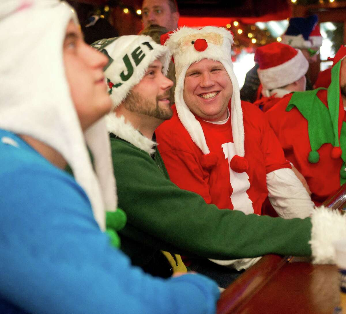 Drew LaBov talks with friends at Murphy's during Stamford SantaCon on Saturday, December 6, 2014.