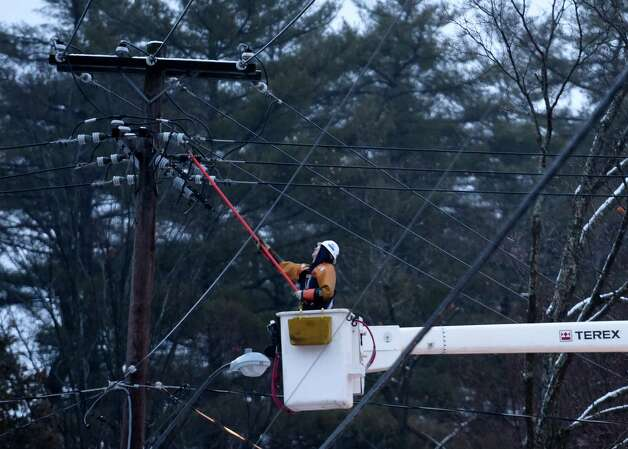 National Grid workers work on a spot power outage on Nelson Avenue Wednesday morning, Dec. 10, 2014, in Saratoga Springs, N.Y. (Skip Dickstein/Times Union) Photo: SKIP DICKSTEIN