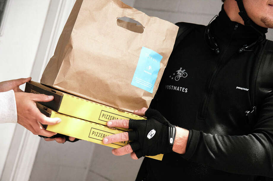 Postmates offers 'get it now' delivery service to merchants