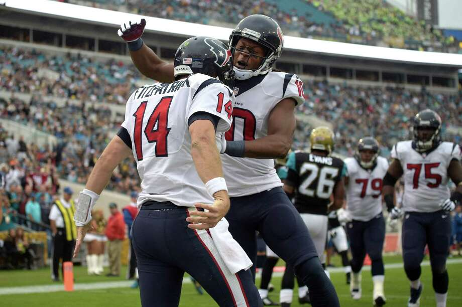 Houston Texans wide receiver DeAndre Hopkins (10) congratulates quarterback Ryan Fitzpatrick (14) after Fitzpatrick rushed for a touchdown during the first half of an NFL football game against the Jacksonville Jaguars in Jacksonville, Fla., Sunday, Dec. 7, 2014. Photo: Phelan M. Ebenhack / Phelan M. Ebenhack / Associated Press / FR121174 AP