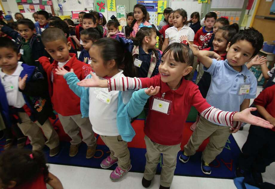 Pre-kindergarten students rehearse a song for their holiday program at Benbrook Elementary School in December 2014. HISD issued 184 suspensions to pre-K students the 2014-15 school year. ( Mayra Beltran / Houston Chronicle ) Photo: Mayra Beltran, Staff / © 2014 Houston Chronicle