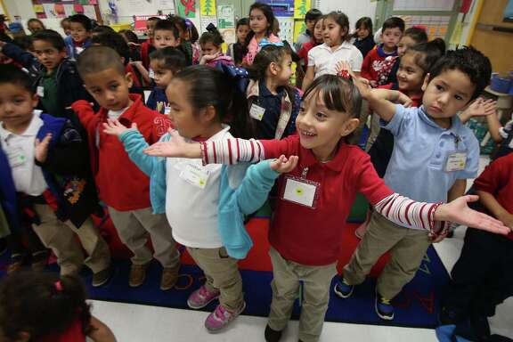 Pre-kindergarten students rehearse a song for their holiday program at Benbrook Elementary School on Wednesday, Dec. 10, 2014, in Houston. Texas has lost its bid for federal grant of up to $120 million to expand pre-kindergarten access for students. ( Mayra Beltran / Houston Chronicle )