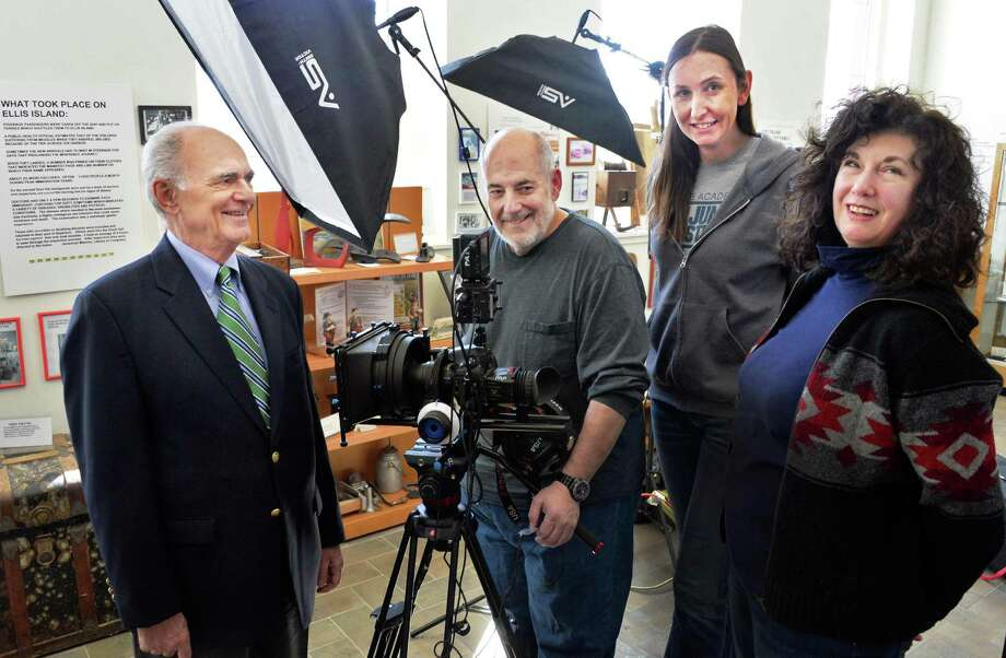 """Co-writers Pat Bulgaro, left, and Mary Paley, right, pose with videographer John Romeo and director of photography Mackenzie Valentine after filming a segment of their film, """"The Neighborhood That Disappeared"""" at the Italian-American Heritage Museum on Friday, March 8, 2014, in Albany, NY.  (John Carl D'Annibale / Times Union) Photo: John Carl D'Annibale / 00026050A"""