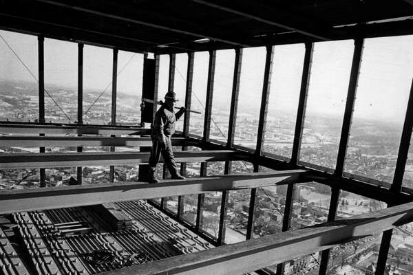 A steel worker operates with the metal superstructure of Corning Tower, undated, in Albany, N.Y. (Times union archive)