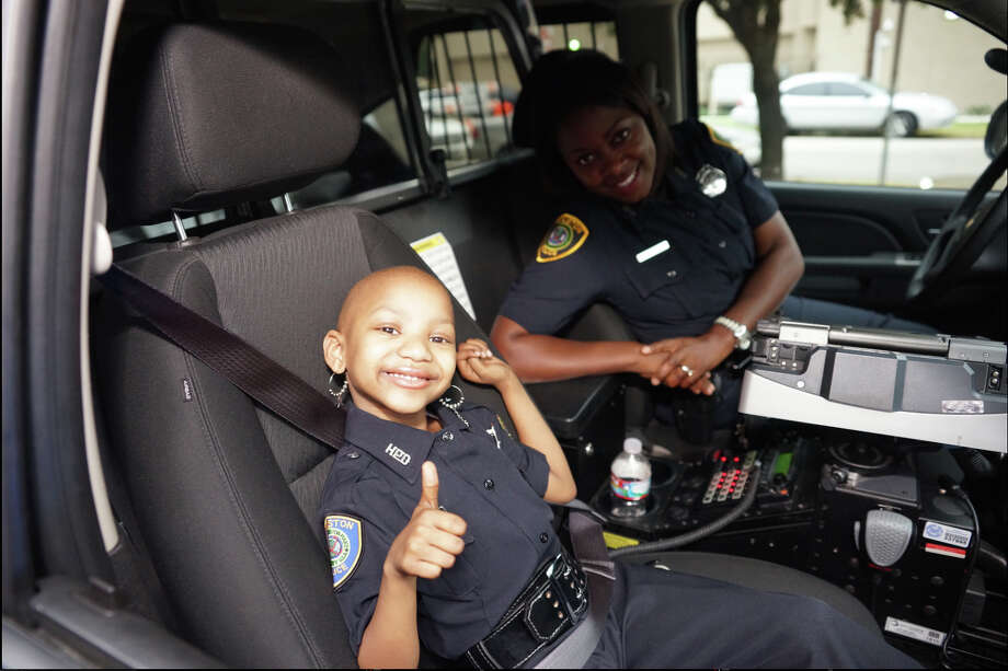 The Houston Police Department made sure that Kyssi Andrews, 6, was able to live out one of her biggest dreams: serving as a Houston cop.  Photo: Photos Courtesy Of HPD / Photos courtesy of HPD