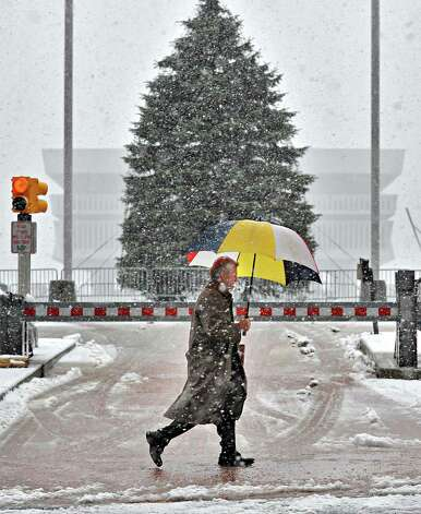 Albert Dingley of Rexford walks along State Street past the Empire State Plaza Christmas tree Wednesday Dec. 10, 2014, in Albany, NY.  (John Carl D'Annibale / Times Union) Photo: John Carl D'Annibale / 00029805A