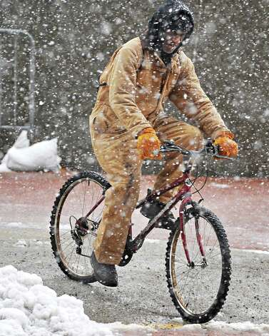 Darryl Walton of Albany bicycles home through a snow storm up State Street Wednesday Dec. 10, 2014, in Albany, NY.  (John Carl D'Annibale / Times Union) Photo: John Carl D'Annibale / 00029805A