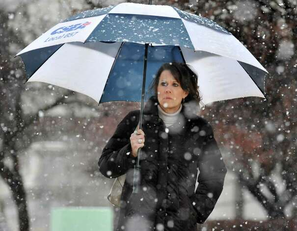 Maureen Fuller of Rotterdam walks along Washington Ave. in Wednesday's snow storm Dec. 10, 2014, in Albany, NY.  (John Carl D'Annibale / Times Union) Photo: John Carl D'Annibale / 00029805A