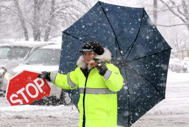 Crossing guard Lil Connor gets children safely accross Sand Creek Road as Sand Creek Middle School lets out for the day on Wednesday Dec. 10, 2014 in Colonie, N.Y.  (Michael P. Farrell/Times Union) Photo: Michael P. Farrell / 00029805A