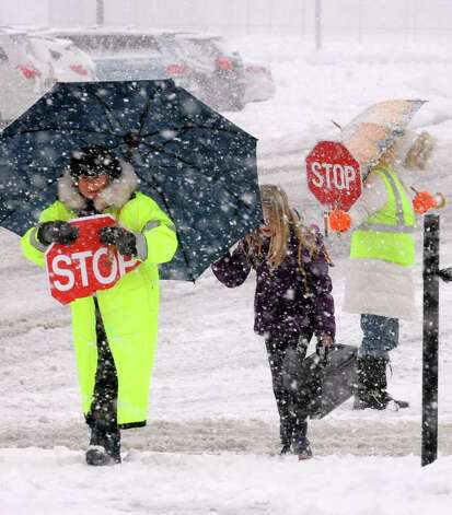 Crossing guard Lil Connor gets children safely across Sand Creek Road as Sand Creek Middle School lets out for the day on Wednesday afternoon, Dec. 10, 2014, in Colonie, N.Y.  (Michael P. Farrell/Times Union) Photo: Michael P. Farrell / 00029805A