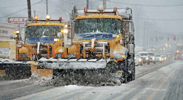 A pair of NYS DOT snow plows clear Central Avenue as heavy snow falls Wednesday Dec. 10, 2014, in Colonie, NY.  (John Carl D'Annibale / Times Union) Photo: John Carl D'Annibale / 00029805A