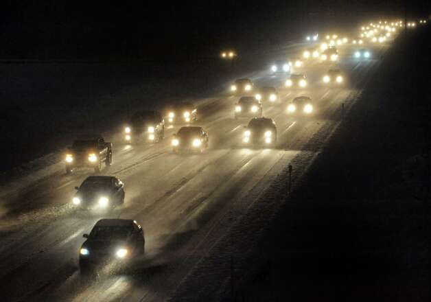Traffic travels north bound on the I-87 as snow falls on Wednesday evening, Dec. 10, 2014, in Colonie, N.Y.  (Michael P. Farrell/Times Union) Photo: Michael P. Farrell / 00029805A