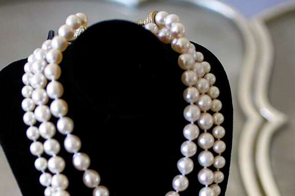 A graduated pearl necklace, $2,950, from RoseRoss.