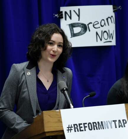 Nicole Ponzo, vice chair of Graduate Student Affairs, University Student Senate joined others during a press conference in the well of the Legislative Office Building Dec. 10, 2014 in Albany, N.Y.,  in calling on Governor Cuomo to modernize the Tuition Assistance Program and include the of the NY Dream Act in the renovation of TAP. (Skip Dickstein/Times Union) Photo: SKIP DICKSTEIN / 00029801A