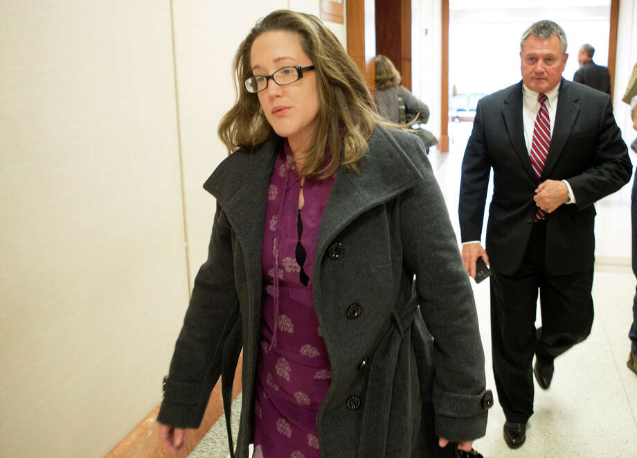 Margaret Mayer leaves the Harris County Criminal Courthouse, Wednesday, Dec. 10, 2014, in Houston. Mayer is accused of failing to stop after her car struck Chelsea Norman, along Waugh Drive as Norman cycled home from her job around 10:20 p.m. on Dec. 1, 2013. (Cody Duty / Houston Chronicle) Photo: Cody Duty, Staff / © 2014 Houston Chronicle
