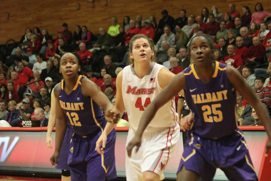 Imani Tate, left, and Shereesha Richards, right, of UAlbany box out for a rebound against Marist's Tori Jarosz on Wednesday, Dec. 10, 2014, in Poughkeepsie. UAlbany outrebounded Marist 47-25. (Marist sports information)