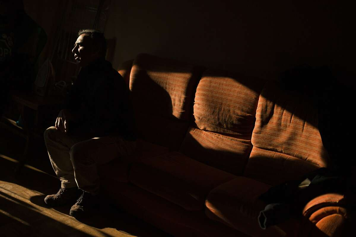 Activist, Antonio Perez Martinez, 53 years old, unemployed, and other housing rights campaigners wait inside Elvira Reyes Mariano's apartment to stop her and her family's eviction in Madrid, Spain, Wednesday, Dec. 10, 2014. The landlord's loss of the apartment to Bankia bank is causing Reyes Mariano and her family's eviction. Reyes Mariano lives with her husband Soltero Rodriguez Cuevas, 44 years old, both unemployed, her sister and their three kids. They continued to occupy a foreclosed Bankia bank apartment after their landlord left as they could not afford to pay rent and they are now trying to negotiate to pay a low rent to the bank. The eviction was postponed with the help of the housing rights activists. (AP Photo/Andres Kudacki)
