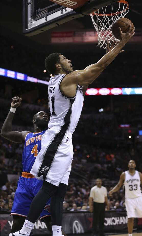 San Antonio Spurs' Jeff Ayres goes under the basket as New York Knicks' Quincy Acy defends during the first half at the AT&T Center, Wednesday, Dec. 10, 2014. Photo: San Antonio Express-News