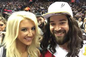 Fans take photos with Spurs Jesus at the AT&T Center on Wednesday, December 10, 2014.