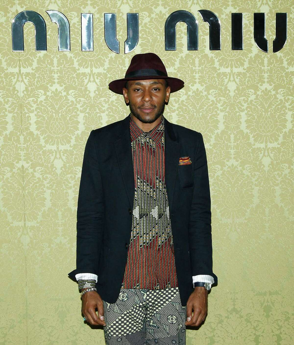 PARIS, FRANCE - JULY 05: Mos Def attends the Miu Miu Resort Collection 2015 at Palais d'Iena on July 5, 2014 in Paris, France. (Photo by Julien M. Hekimian/French Select/Getty Images)