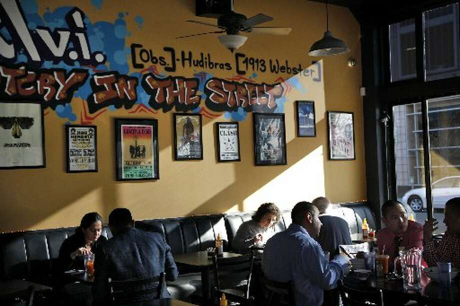 The interior features a graffiti-like graphic along one wall. Photo: Preston Gannaway, Special To The Chronicle