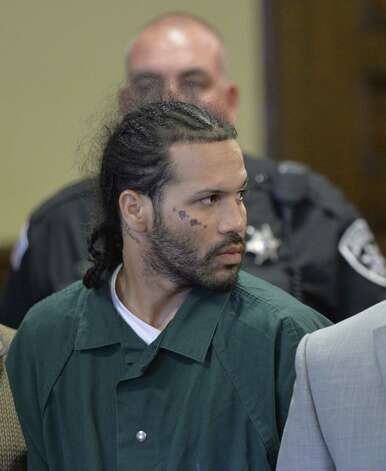 Alexis Torres, center,  appears for his arraignment on murder charges Tuesday afternoon, June 17, 2014, at Rensselaer County Court in Troy, N.Y.  (Skip Dickstein / Times Union) Photo: SKIP DICKSTEIN / 00027384A