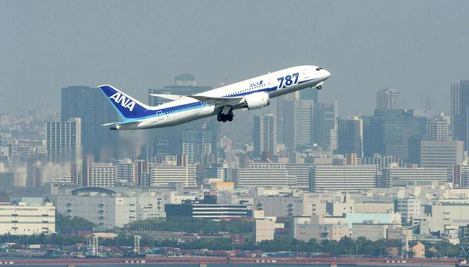 A Japan's All Nippon Airways aricraft flies over Tokyo bay in this file photo. See other major cities that you can reach directly from Houston.  Photo: SUB / Kyodo News