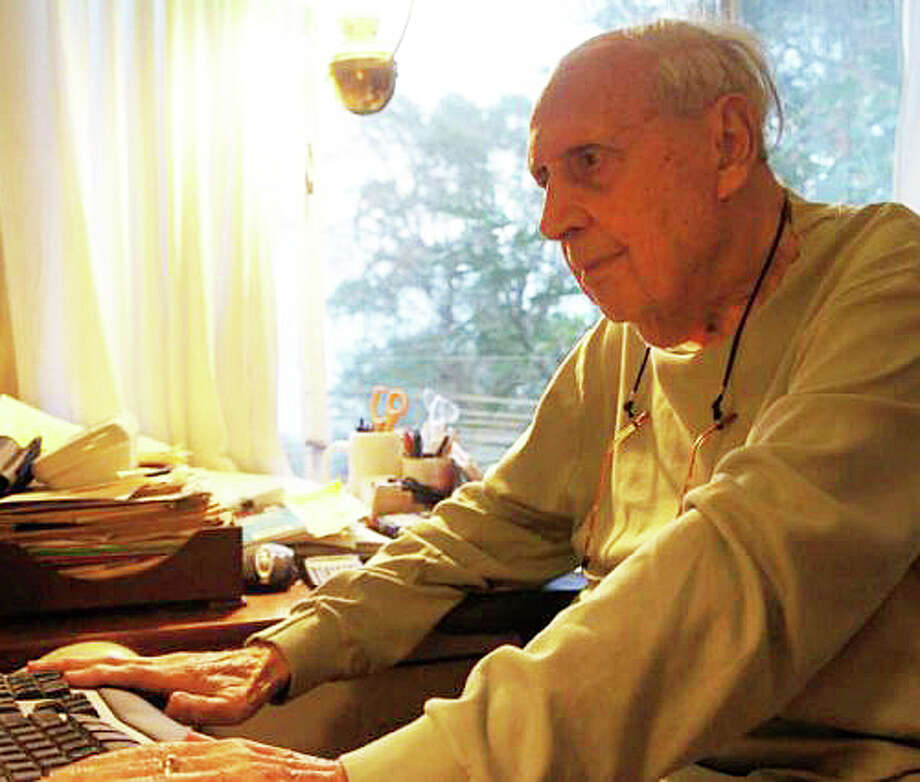 Sidney Kramer, founder of Save Westport Now and co-owner with his late wife Esther of the former Remarkable Book Shop, died Wednesday at age 99. He was photographed in 2011 at work in his home office. Photo: File Photo / Westport News