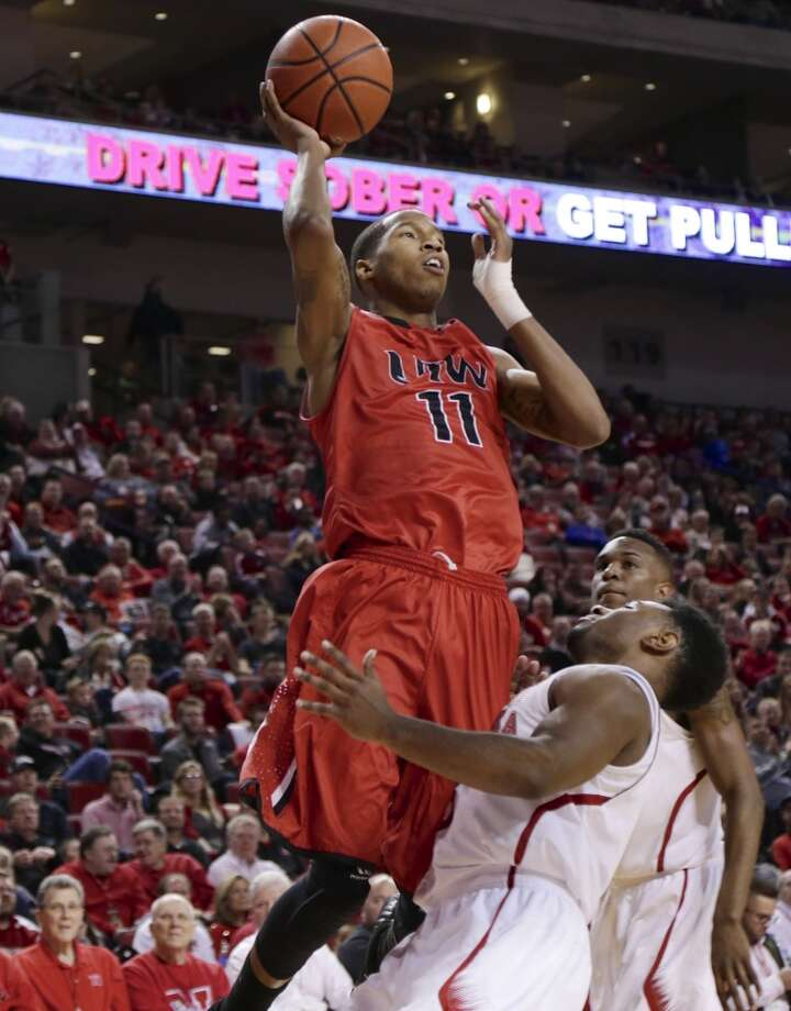 Incarnate Word's Denzel Livingston (11) shoots over Nebraska's Benny Parker (3) during the second half of an NCAA college basketball game in Lincoln, Neb., Wednesday, Dec. 10, 2014. Incarnate Word won 74-73. (AP Photo/Nati Harnik) Photo: Associated Press