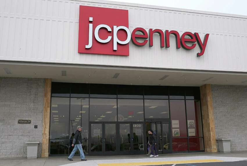 FILE - APRIL 8, 2013: It was reported JC Penney CEO Ron Johnson has stepped down and Mike Ullman will rejoin the company as CEO April 8, 2013. DALY CITY, CA - FEBRUARY 28: People walk by a JCPenney store on February 28, 2013 in Daly City, California. J.C. Penney Co. reported a 31.7 percent drop in fourth quarter earnings with a net loss of $552 million, or $2.51 per share compared with a loss of $87 million, or $0.41 one year ago.
