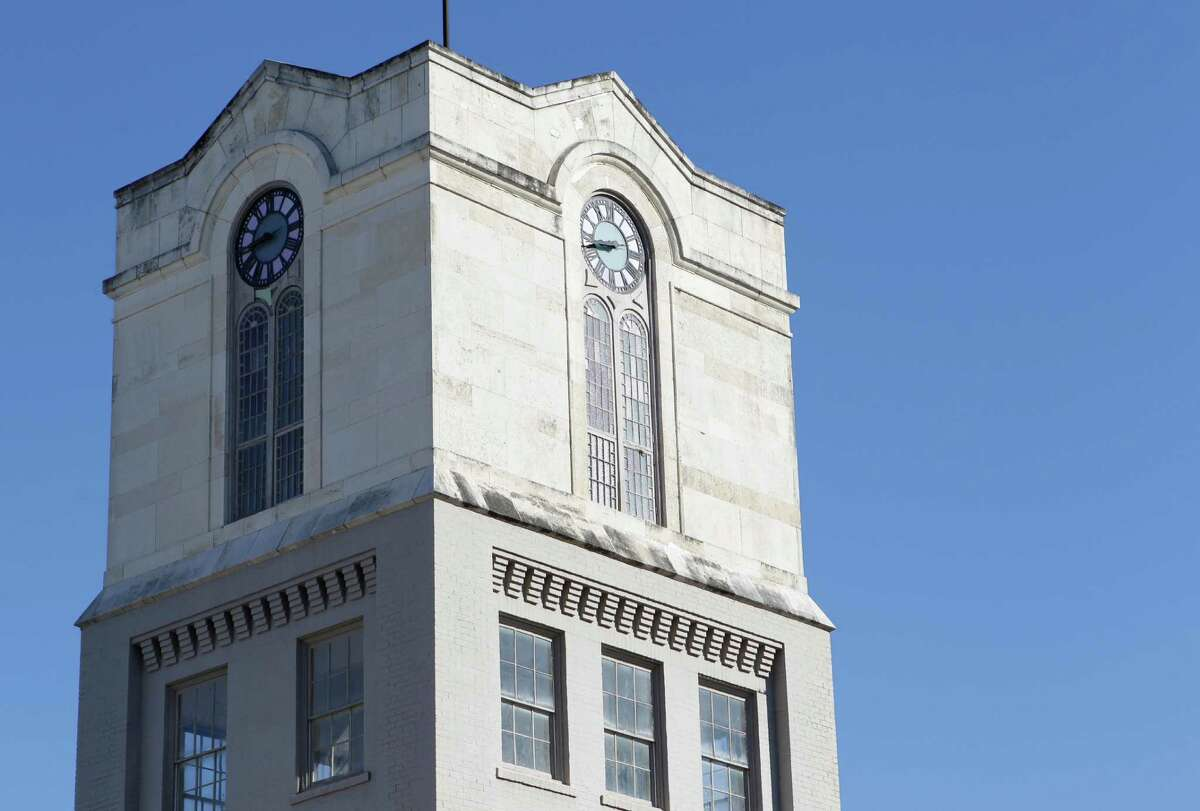 The historic Heights Clock Tower stands above an industrial building at 611 West 22nd St.