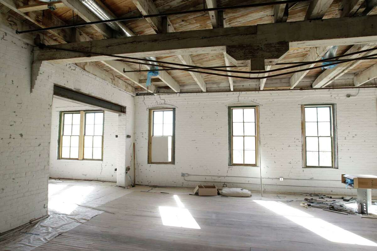 The top floors are being converted into office and apartment space, with care taken to keep as much intact as possible.